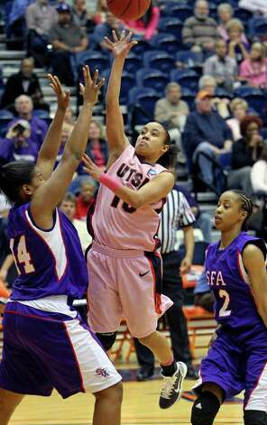 SPORTS   Roadrunner guard Amber Gregg shoots over Chantol Drennan (44) after breaking away from Ebony Alexander as the UTSA women play Stephen F. Austin at the UTSA Convocation Center on February 12, 2011. Tom Reel/Staff Photo: TOM REEL, SAN ANTONIO EXPRESS-NEWS / © 2011 San Antonio Express-News