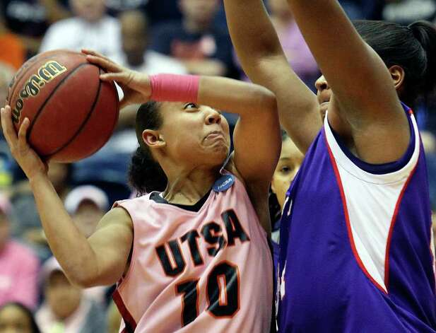 SPORTS   UTSA guard Amber Gregg draws the foul under tha basket against Chantol Drennan as the UTSA women play Stephen F. Austin at the UTSA Convocation Center on February 12, 2011. Tom Reel/Staff Photo: TOM REEL, SAN ANTONIO EXPRESS-NEWS / © 2011 San Antonio Express-News