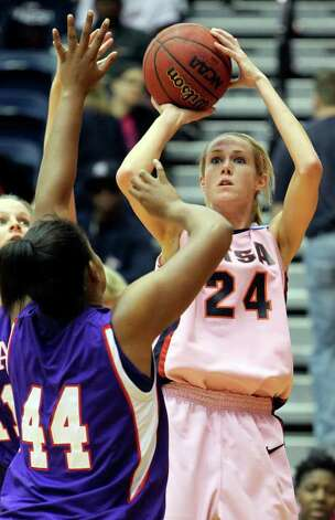 SPORTS   Alysse Davis fires a shot over Chantol Drennan as the UTSA women play Stephen F. Austin at the UTSA Convocation Center on February 12, 2011. Tom Reel/Staff Photo: TOM REEL, SAN ANTONIO EXPRESS-NEWS / © 2011 San Antonio Express-News