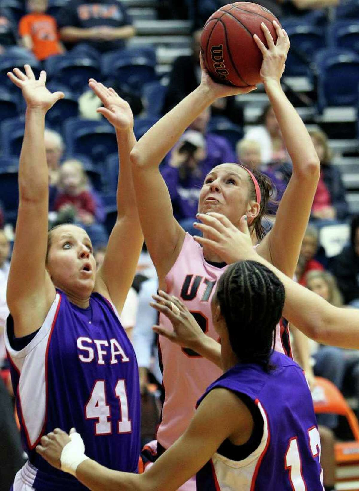 SPORTS Lyndi Thorman puts the ball up in a crowd of SFA defenders including Cheyenne Berry (12) and Ebony alexander as the UTSA women play Stephen F. Austin at the UTSA Convocation Center on February 12, 2011. Tom Reel/Staff