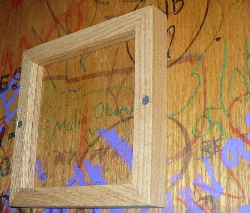 Presidential daughter Malia Obama, like many other patrons, signed the wall in the Medici restaurant, where the Obama family enjoyed eating. It is now protected under glass and framed. (Photo by Michael Schuman)