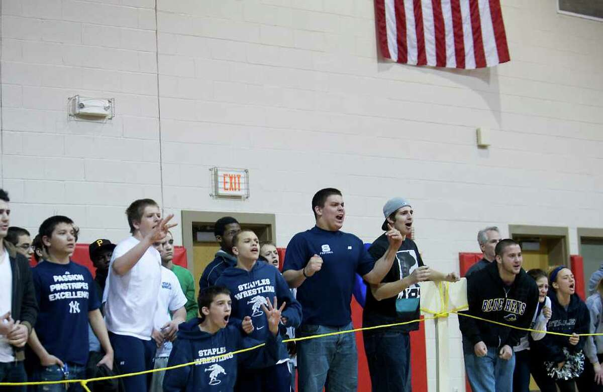 Fans cheer during a match at the FCIAC wrestling championship at New Canaan High School in New Canaan, Conn. on Saturday February 12, 2011.