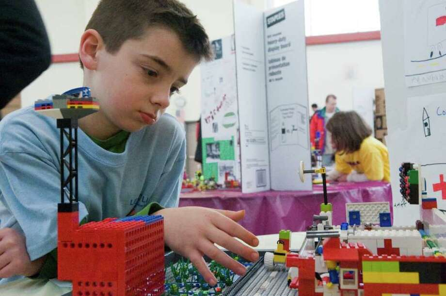 Christopher Reitwiesner, 6, examines his project during the Fourth Annual Stamford Lego Robotics Exposition at the Academy of Information and Technology in Stamford, Conn., February 13, 2011.  More than 180 students participated in the event. Photo: Keelin Daly / Stamford Advocate
