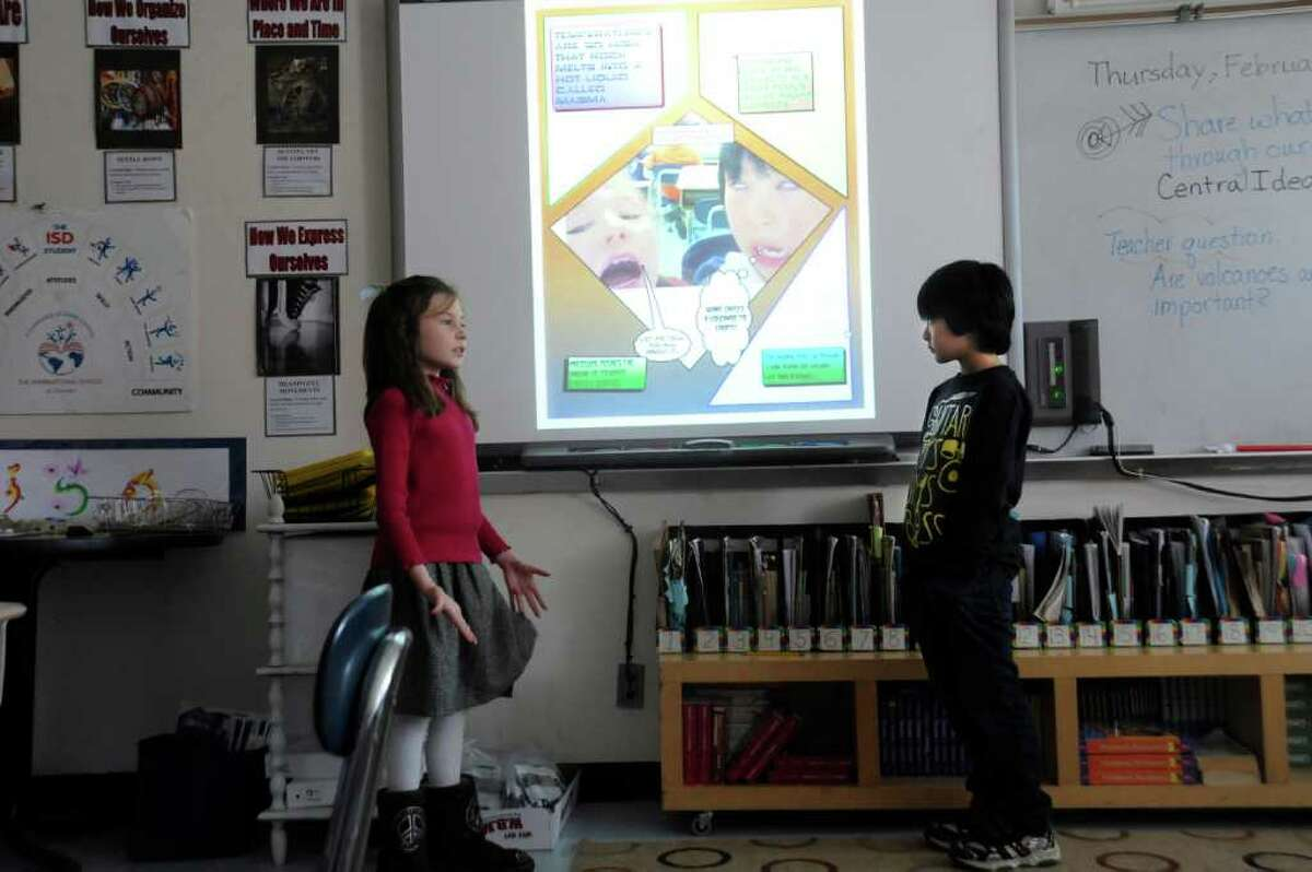 Gracie McCooe, left, and Emanuel Lai, International School of Dundee third-graders, working together to present their learning about rocks on Thursday, Feb. 10, 2011.