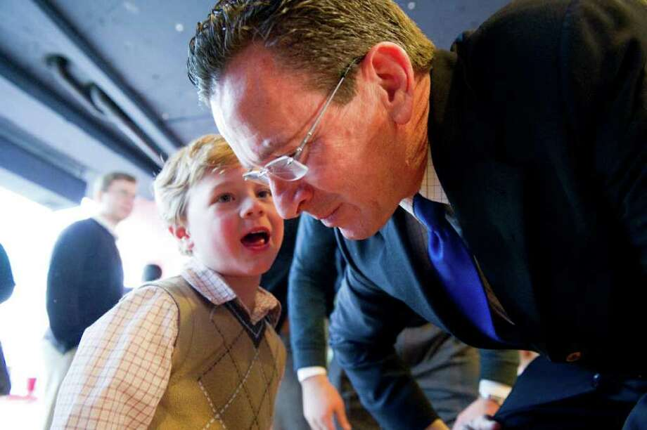 Gov. Dannel Malloy gets an earful from Zachary Louizos, 4, at a rally for state Rep. Carlo Leone at Democratic headquarters in Stamford, Conn., February 13, 2011. Lt. Gov. Nancy Wyman, Sen. Richard Blumenthal and Congressmen Jim Himes and Chris Murphy were among the guests. Leone is running for Andrew McDonald's seat in the 27th state senate district, the special election is on Feb. 22. Photo: Keelin Daly / Stamford Advocate