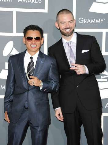 LOS ANGELES, CA - FEBRUARY 13:  Rapper Paul Wall (R) and jeweler Johnny Dang arrive at The 53rd Annual GRAMMY Awards held at Staples Center on February 13, 2011 in Los Angeles, California.  (Photo by Jason Merritt/Getty Images) *** Local Caption *** Johnny Dang;Paul Wall Photo: Jason Merritt, Getty Images / 2011 Getty Images