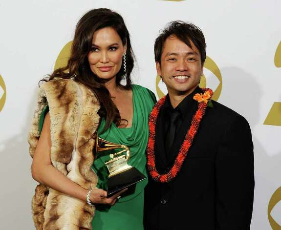 "LOS ANGELES, CA - FEBRUARY 13:  Musician Tia Carrere, winner of the Best Hawaiian Music Album for ""Huana Ke Aloha"" and musician Daniel Ho pose in the press room at The 53rd Annual GRAMMY Awards held at Staples Center on February 13, 2011 in Los Angeles, California.  (Photo by Kevork Djansezian/Getty Images) *** Local Caption *** Tia Carrere;Daniel Ho Photo: Kevork Djansezian, Getty Images / 2011 Getty Images"