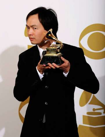 "LOS ANGELES, CA - FEBRUARY 13:  Arranger Christopher Tin, winner of the Best Instrumental Arrangement Accompanying Vocalist(s) award for ""Baba Yetu"" poses in the press room at The 53rd Annual GRAMMY Awards held at Staples Center on February 13, 2011 in Los Angeles, California.  (Photo by Kevork Djansezian/Getty Images) *** Local Caption *** Christopher Tin Photo: Kevork Djansezian, Getty Images / 2011 Getty Images"