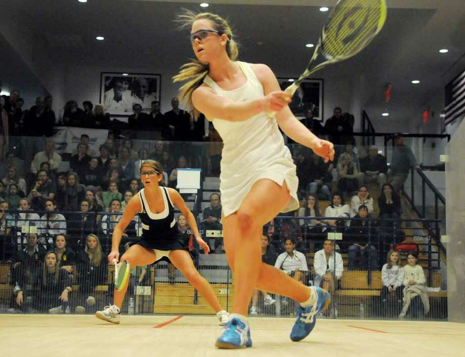 Greenwich's Nina Scott (foreground) volleys against Deerfield's Charlotte Dewey as Greenwich Academy competes against Deerfield Academy in the finals of the U.S. high school team squash championship at Yale's Payne Whitney Gym in New Haven, CT on Sunday, February 13, 2011. Photo: Shelley Cryan / Shelley Cryan freelance; Greenwich Time freelance