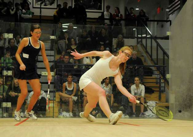 Greenwich's Alex Lunt (foreground) returns a volley against Deerfield's Emily Jones as Greenwich Academy competes against Deerfield Academy in the finals of the U.S. high school team squash championship at Yale's Payne Whitney Gym in New Haven, CT on Sunday, February 13, 2011. Photo: Shelley Cryan / Shelley Cryan freelance; Greenwich Time freelance