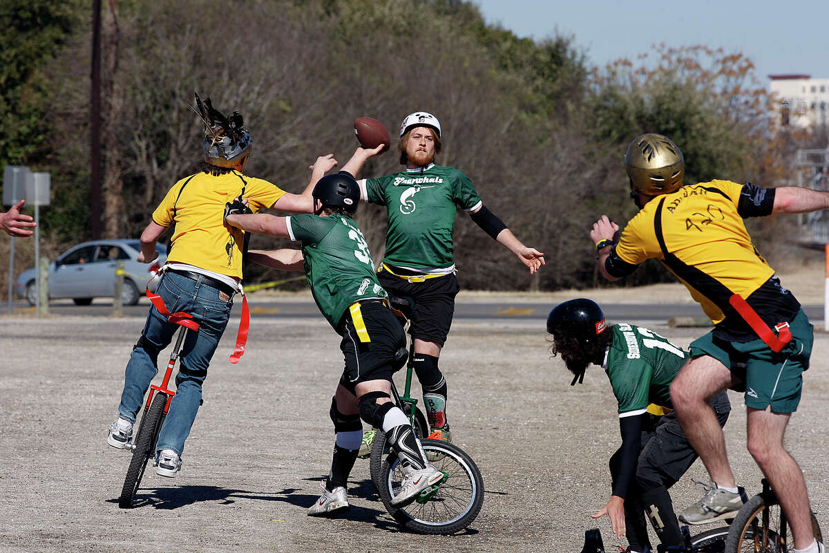 Gnarwhals quarterback, BP, looks downfield as they play the Ill-Eagles in the Unicycle Football League at the Farmer's Market parking lot in San Marcos, Texas, Sunday, Feb. 13, 2011.