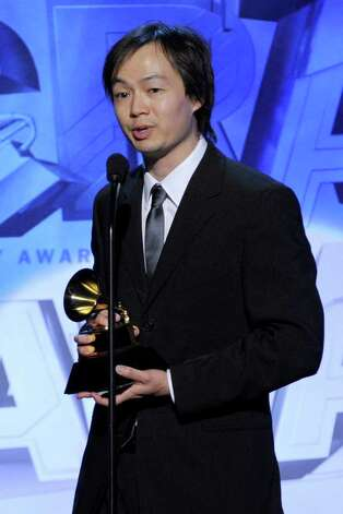 LOS ANGELES, CA - FEBRUARY 13:  Arranger Christopher Tin accepts Best Instrumental Arrangement With Vocalist(s) Award for Baba Yetu onstage during The 53rd Annual GRAMMY Awards held at Staples Center on February 13, 2011 in Los Angeles, California.  (Photo by Kevin Winter/Getty Images) *** Local Caption *** Christopher Tin Photo: Kevin Winter, Getty Images / 2011 Getty Images