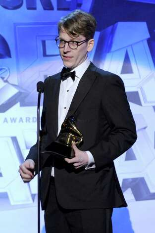 LOS ANGELES, CA - FEBRUARY 13: Art Director Michael Carney accepts the Best Recording Package Award for The Black Keys onstage during The 53rd Annual GRAMMY Awards held at Staples Center on February 13, 2011 in Los Angeles, California.  (Photo by Kevin Winter/Getty Images) *** Local Caption *** Michael Carney Photo: Kevin Winter, Getty Images / 2011 Getty Images