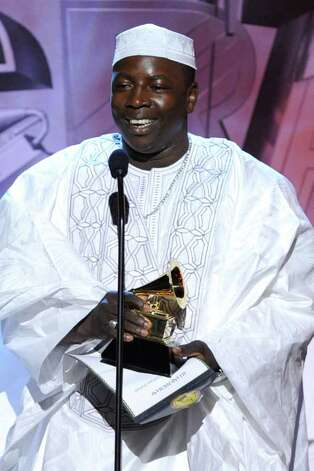 LOS ANGELES, CA - FEBRUARY 13:  Musician Ali Farka Toure accepts the Best Traditional World Music Album Award for Ali And Toumani onstage during The 53rd Annual GRAMMY Awards held at Staples Center on February 13, 2011 in Los Angeles, California.  (Photo by Kevin Winter/Getty Images) *** Local Caption *** Ali Farka Photo: Kevin Winter, Getty Images / 2011 Getty Images