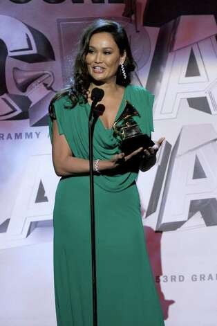 LOS ANGELES, CA - FEBRUARY 13:  Singer Tia Carrere accepts the Best Hawaiian Music Album Award for Huana Ke Aloha onstage during The 53rd Annual GRAMMY Awards held at Staples Center on February 13, 2011 in Los Angeles, California.  (Photo by Kevin Winter/Getty Images) *** Local Caption *** Tia Carrare Photo: Kevin Winter, Getty Images / 2011 Getty Images