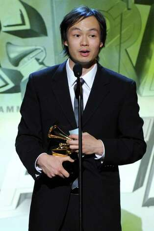 LOS ANGELES, CA - FEBRUARY 13:  Arranger Christopher Tin accepts the Best Classical Crossover Award onstage during The 53rd Annual GRAMMY Awards held at Staples Center on February 13, 2011 in Los Angeles, California.  (Photo by Kevin Winter/Getty Images) *** Local Caption *** Christopher Tin Photo: Kevin Winter, Getty Images / 2011 Getty Images