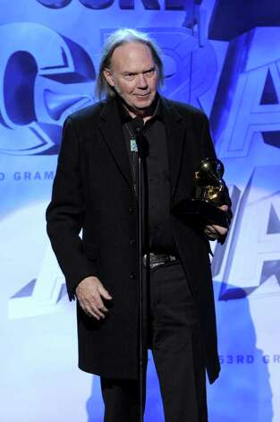 LOS ANGELES, CA - FEBRUARY 13:  Musician Neil Young accepts the Best Rock Song Award onstage during The 53rd Annual GRAMMY Awards held at Staples Center on February 13, 2011 in Los Angeles, California.  (Photo by Kevin Winter/Getty Images) *** Local Caption *** Neil Young Photo: Kevin Winter, Getty Images / 2011 Getty Images