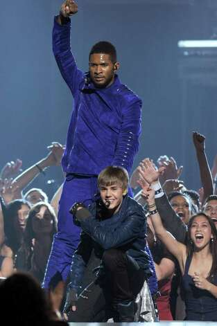 LOS ANGELES, CA - FEBRUARY 13:  Singers Usher and Justin Bieber perform onstage during The 53rd Annual GRAMMY Awards held at Staples Center on February 13, 2011 in Los Angeles, California.  (Photo by Kevin Winter/Getty Images) *** Local Caption *** Usher;Justin Bieber Photo: Kevin Winter, Getty Images / 2011 Getty Images