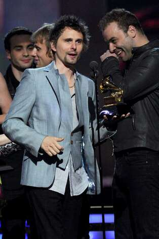 "LOS ANGELES, CA - FEBRUARY 13:  Musician Matthew Bellamy (L) and Christopher Wolstenholme of the band Muse accpet the Best Rock Album award for ""The Resistance"" onstage during The 53rd Annual GRAMMY Awards held at Staples Center on February 13, 2011 in Los Angeles, California.  (Photo by Kevin Winter/Getty Images) *** Local Caption *** Matthew Bellamy;Christopher Wolstenholme Photo: Kevin Winter, Getty Images / 2011 Getty Images"