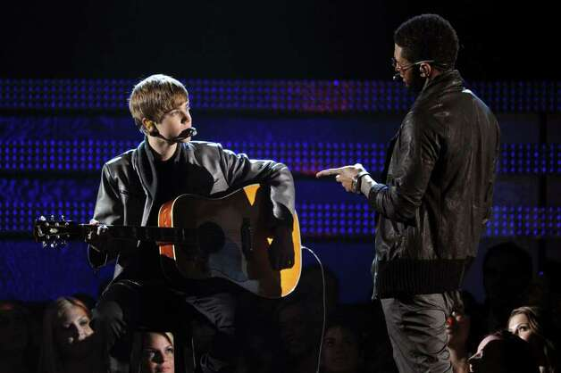 LOS ANGELES, CA - FEBRUARY 13:  Singers Justin Bieber (L) and Usher perform onstage during The 53rd Annual GRAMMY Awards held at Staples Center on February 13, 2011 in Los Angeles, California.  (Photo by Kevin Winter/Getty Images) *** Local Caption *** Justin Bieber;Usher Photo: Kevin Winter, Getty Images / 2011 Getty Images