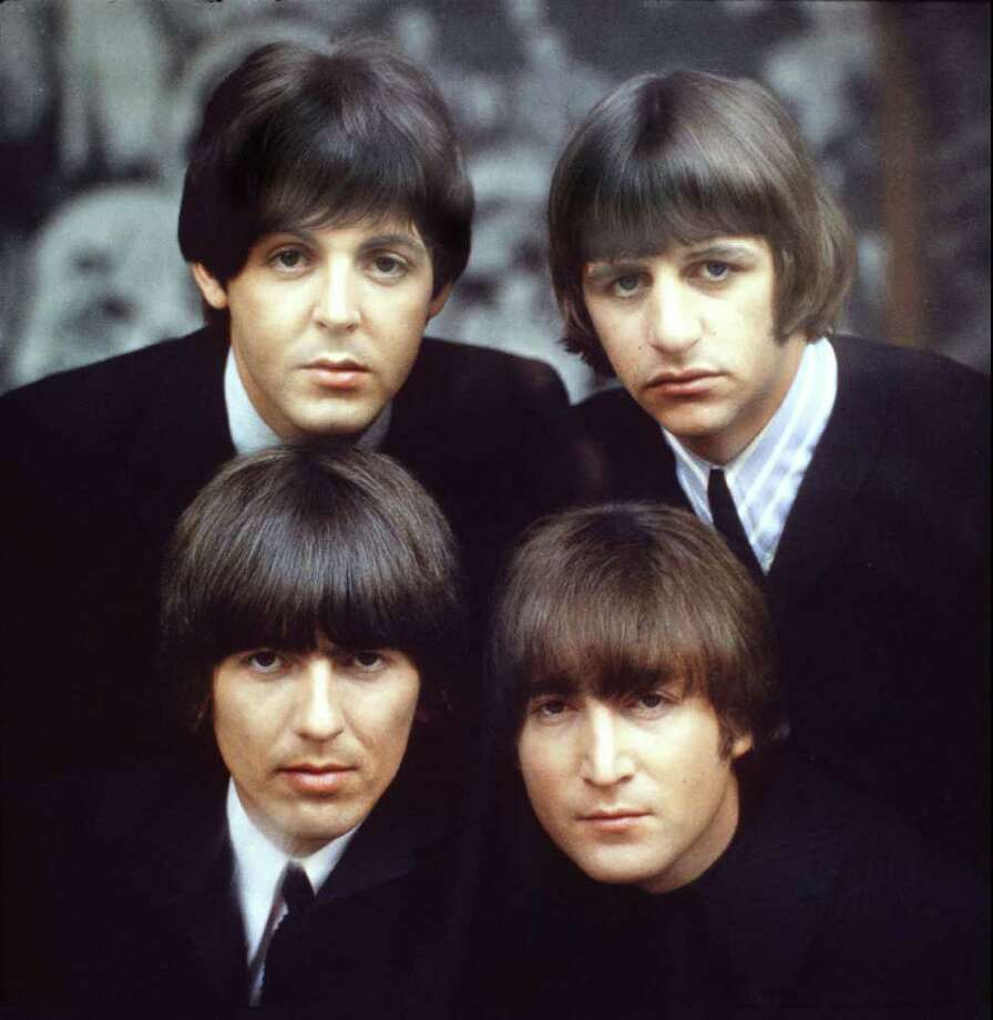 The Beatles, clockwise from top left, Paul McCartney, Ringo Starr, John Lennon, and George Harrison are shown on an album cover in 1965. Photo: ROBERT FREEMAN, HO / APPLE CORPS LTD.