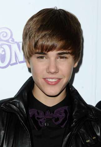 "Singer Justin Bieber attends his premiere of ""Never Say Never"" in New York on Wednesday, Feb. 2, 2011. (AP Photo/Peter Kramer) Photo: Peter Kramer, FRE / KRAPE"