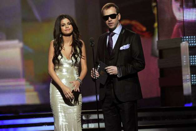 LOS ANGELES, CA - FEBRUARY 13:  Singers Selena Gomez and Donnie Wahlberg speak onstage during The 53rd Annual GRAMMY Awards held at Staples Center on February 13, 2011 in Los Angeles, California.  (Photo by Kevin Winter/Getty Images) *** Local Caption *** Selena Gomez;Donnie Wahlberg Photo: Kevin Winter, Getty Images / 2011 Getty Images