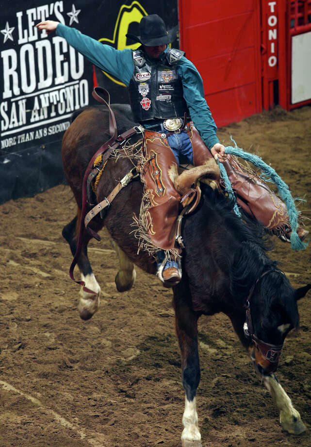 JJ Elshere, from Quinn, SD, competes in the Saddle Bronc Riding event Sunday Feb. 13, 2011 during the San Antonio Stock Show & Rodeo at the AT&T Center. Elshere scored a 76 on the ride. Photo: EDWARD A. ORNELAS/eaornelas@express-news.net
