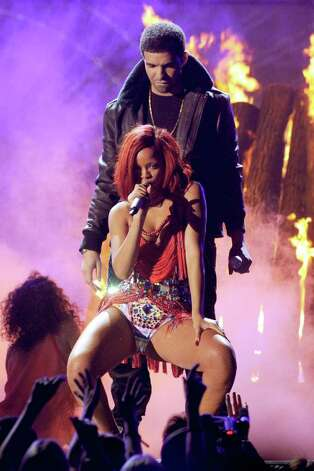 LOS ANGELES, CA - FEBRUARY 13:  Singers Drake (L) and Rihanna perform onstage during The 53rd Annual GRAMMY Awards held at Staples Center on February 13, 2011 in Los Angeles, California.  (Photo by Kevin Winter/Getty Images) *** Local Caption *** Drake;Rihanna Photo: Kevin Winter, Getty Images / 2011 Getty Images