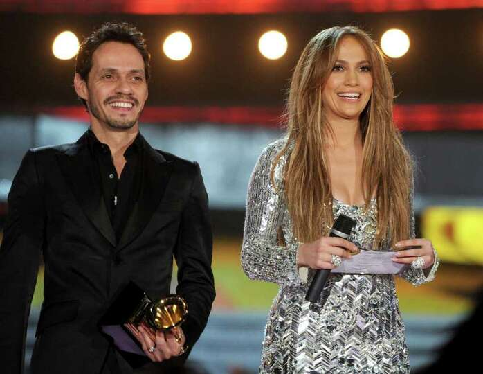 LOS ANGELES, CA - FEBRUARY 13:  Singer Marc Anthony and actress Jennifer Lopez speak onstage during