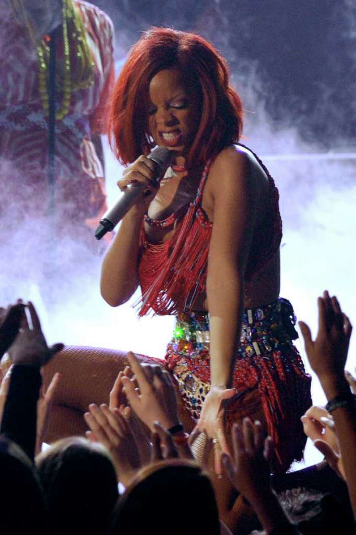 LOS ANGELES, CA - FEBRUARY 13: Rihanna performs onstage during The 53rd Annual GRAMMY Awards held at Staples Center on February 13, 2011 in Los Angeles, California. (Photo by Kevin Winter/Getty Images) *** Local Caption *** Rihanna
