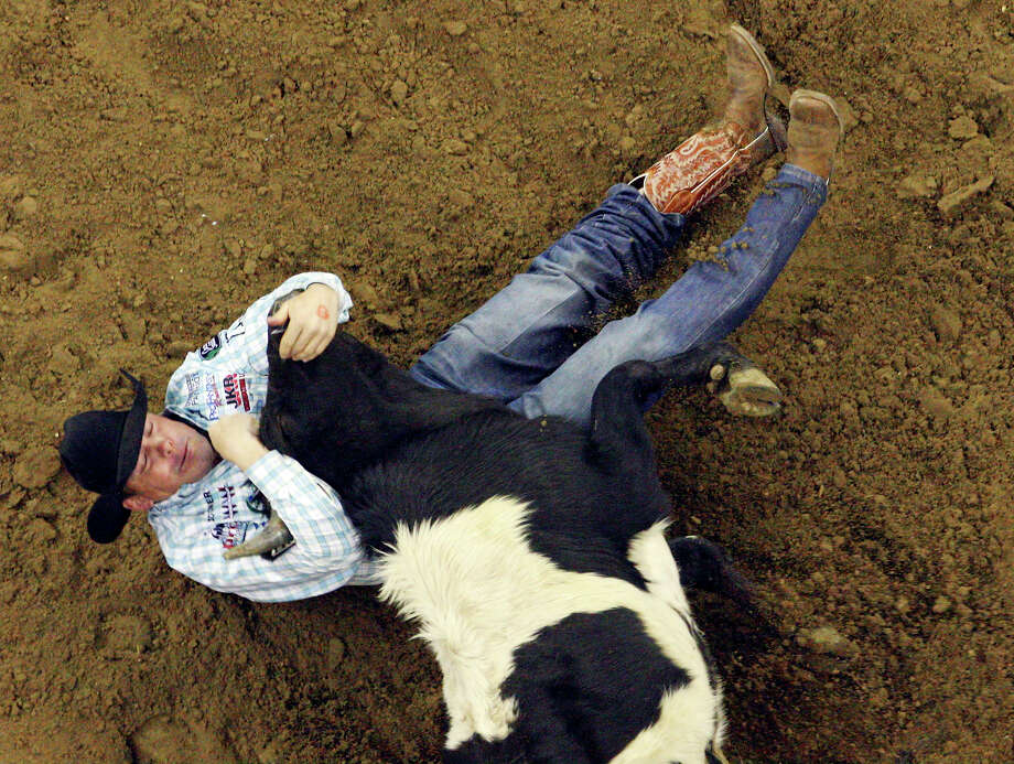 K.C. Jones, from Decatur, TX, competes in the Steer Wrestling event Sunday Feb. 13, 2011 during the San Antonio Stock Show & Rodeo at the AT&T Center. Jones' time was 4.9 seconds. Photo: EDWARD A. ORNELAS/eaornelas@express-news.net