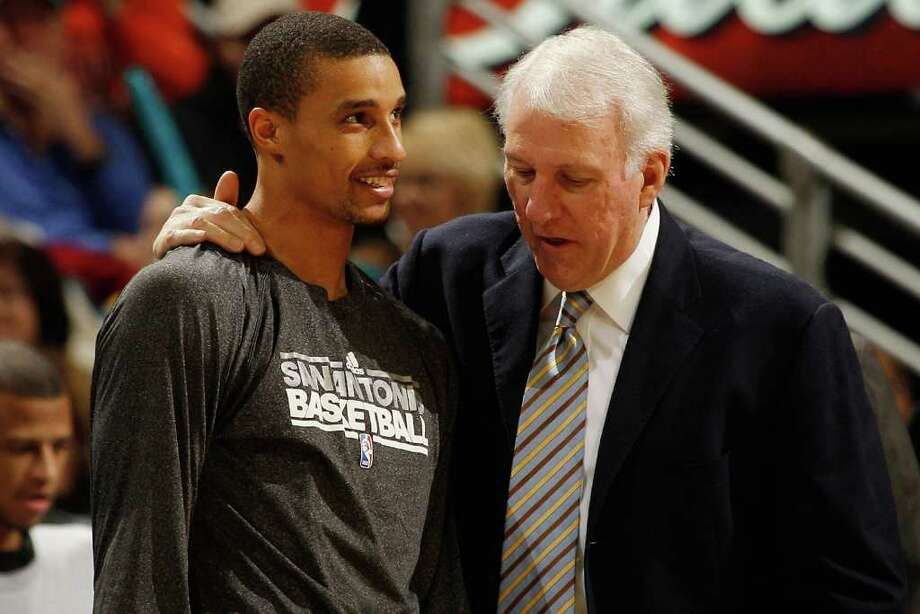 Coach Gregg Popovich inserted George Hill (left) into the lineup for Saturday's victory at Washington, marking the first time all season the Spurs made a dent in their starting five. Photo: Chris Graythen, Getty Images / 2011 Getty Images