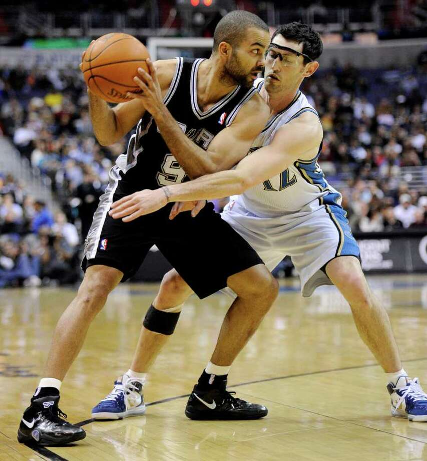 "Spurs guard Tony Parker (left), shown under pressure from Washington Wizards guard Kirk Hinrich, has been in All-Star form since basketball became his ""escape"" from personal drama. Photo: NICK WASS, ASSOCIATED PRESS"