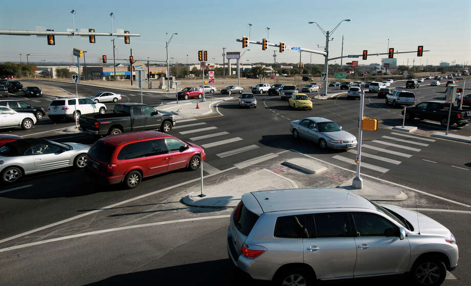 "Traffic flows smoothly at Evans Road and U.S. 281 at the start of a recent rush hour. The intersection is one of four on the highway to undergo ""superstreet"" improvements. Photo: Tom Reel/treel@express-news.net / © 2011 San Antonio Express-News"
