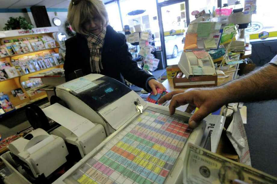 A customer makes a taxable purchase at Coulson's in Loudonville Feb. 10, 2011.( Michael P. Farrell/Times Union ) Photo: Michael P. Farrell