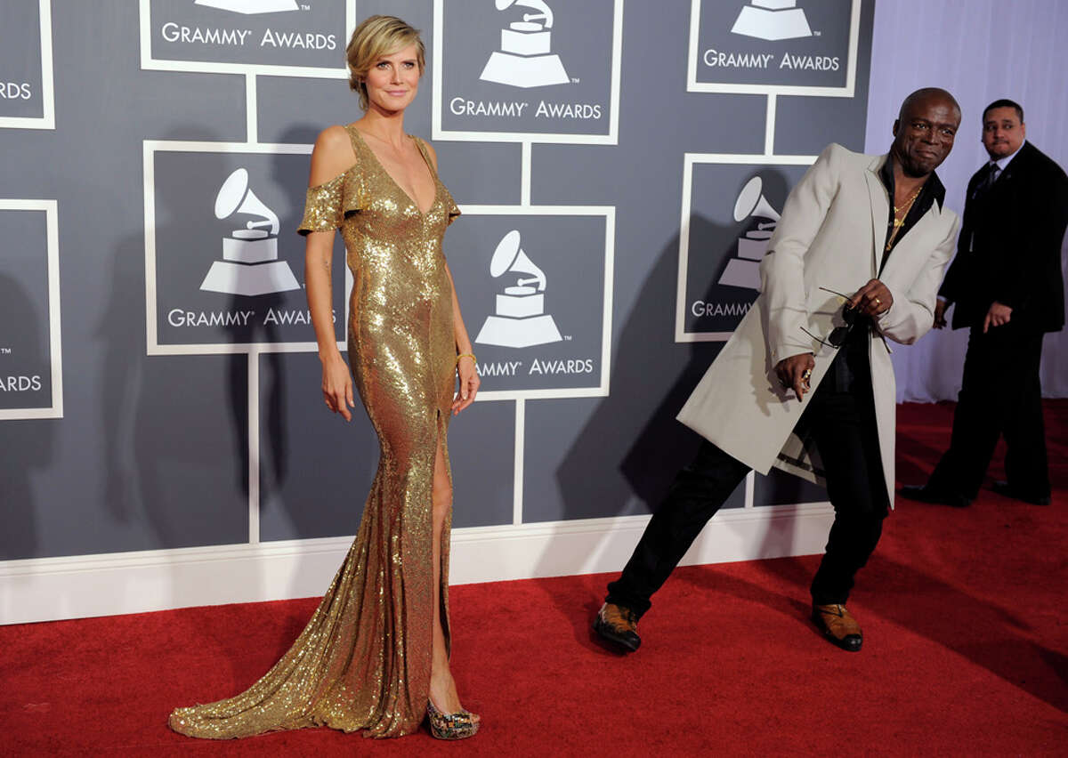 Projected red carpet runway: Heidi Klum set the gold standard on the red carpet in a Julien Macdonald sequined gown. Hubby Seal (right) wore a long white coat over his evening duds. WORDS BY MICHAEL QUINTANILLA / EXPRESS-NEWS; PHOTO BY ASSOCIATED PRESS