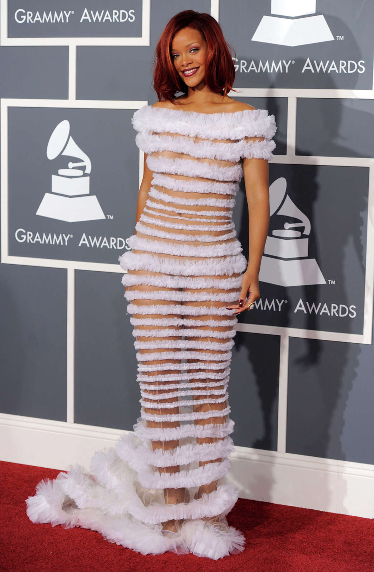 Rihanna, really?: Girlfriend, you look like a towering caterpillar. Wait, scratch that. Let's attach a stick to your head and you're a bottle brush. This wacky gown looks like Jean Paul Gaultier has taken steroid-infused pipe cleaners and stacked them with alternating sheer panels that reveal flesh underneath. We noticed that you sported sparkly pasties, but how about panties? That's anyone's guess unless Britney was nearby. WORDS BY MICHAEL QUINTANILLA / EXPRESS-NEWS; PHOTO BY ASSOCIATED PRESS