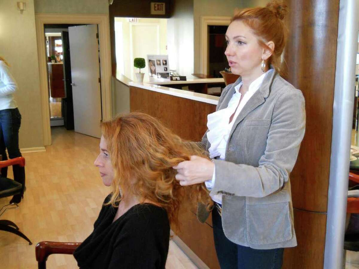 Ewa Marcinczyk, a senior stylist at Giancarlo De Beradinis salon in downtown Greenwich, takes a look at HealthyLife cover model Carol Shwidock's hair and creates a plan of action for styling.