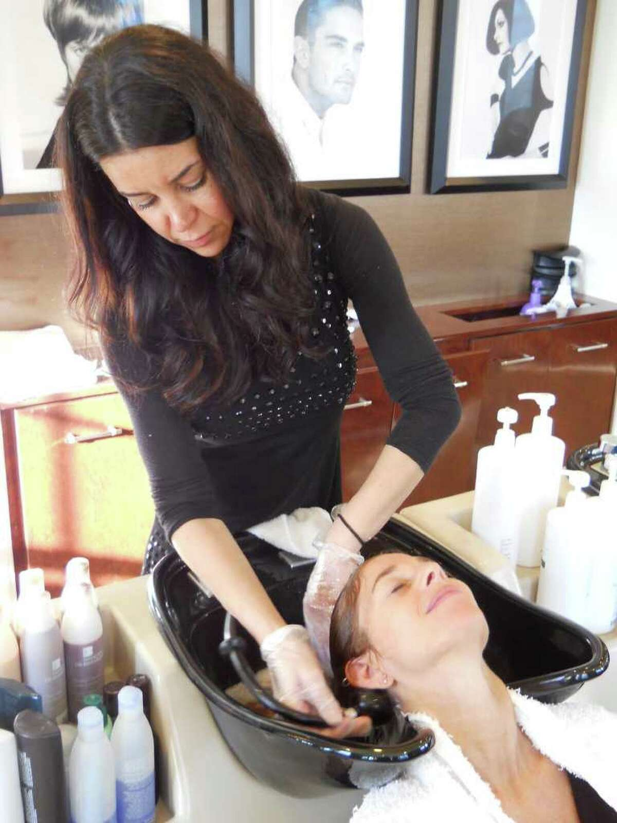 Assistant stylist Andreia Ferreira gives Carol a hair wash ?' and a relaxing scalp massage.