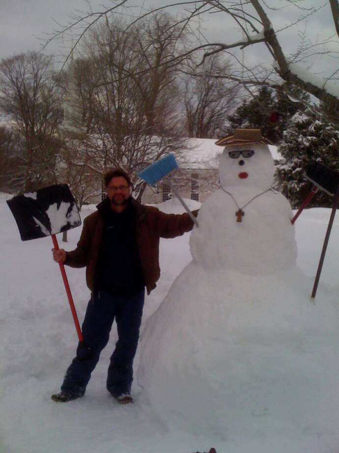 """Rev. Matthew Calkins, rector of St. Timothy's Episcopal Church, with the """"snow bishop"""" at the Congress Street church. Photo: Contributed Photo / Fairfield Citizen contributed"""