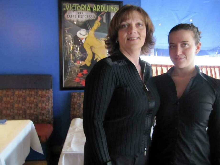 """Anna Lia, left, an owner of Vino's restaurant in Fairfield, is shown with daughter Claudia, a partner in the business. The restaurant's cuisine will be featured at the Fairfield Chamber of Commerce """"Spring Fling."""" Photo: Contributed Photo / Fairfield Citizen contributed"""