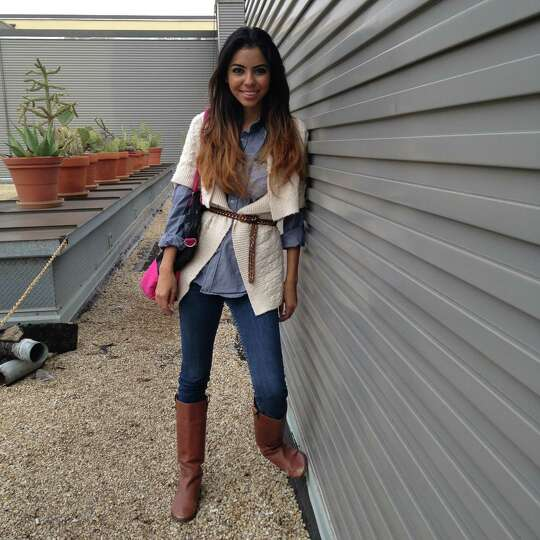 Mariah Medina borrows from the boys with her denim outfit that includes a man's chambray shir
