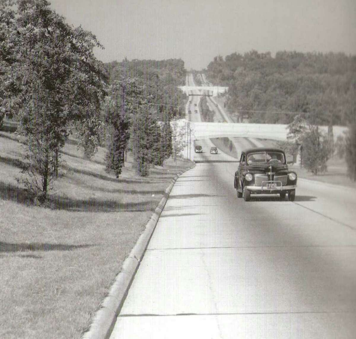 Historic photo of the Merritt from the Connecticut State Library; they also appeared in *Historic Photos of Connecticut*, edited by Sam L. Rothman, Turner Publishing Co. It shows traffic (?) on the Greenwich to Norwalk segment soon after opening day in June, 1938.