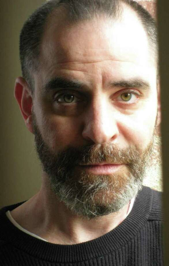 "Humorist David Rakoff - of the NPR series ""This American Life"" - will take part in the ""Selected Shorts"" program at Long Wharf Theatre on March 18 during which stories will be read by Rakoff and longtime ""Sesame Street"" cast member Sonia Manzano. Photo: Contributed Photo / Connecticut Post Contributed"