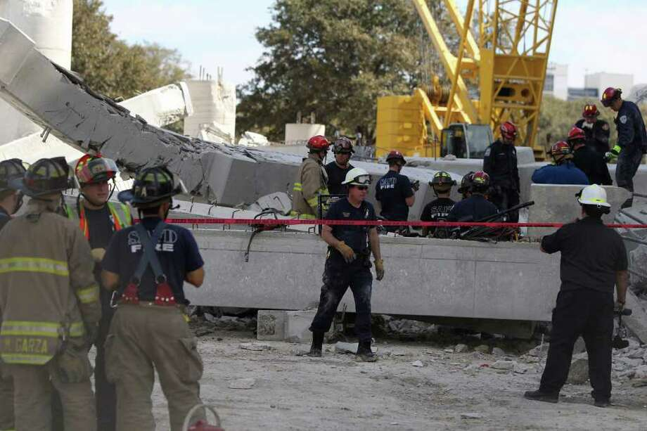 San Antonio firefighters work the scene of a parking garage that collapsed in the Medical Center at the corner of Wurzbach and Medical Monday Febrary 14, 2011. About 120 workers got out before the collapse. Photo: JOHN DAVENPORT, SAN ANTONIO EXPRESS-NEWS / jdavenport@express-news.net