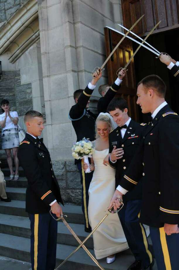Allie Parkhurst and Lt . Will iam Caffery Jr. were married at The West Point Cadet Chapel on July 3, 2010. Photo: Contributed Photo / Westport News