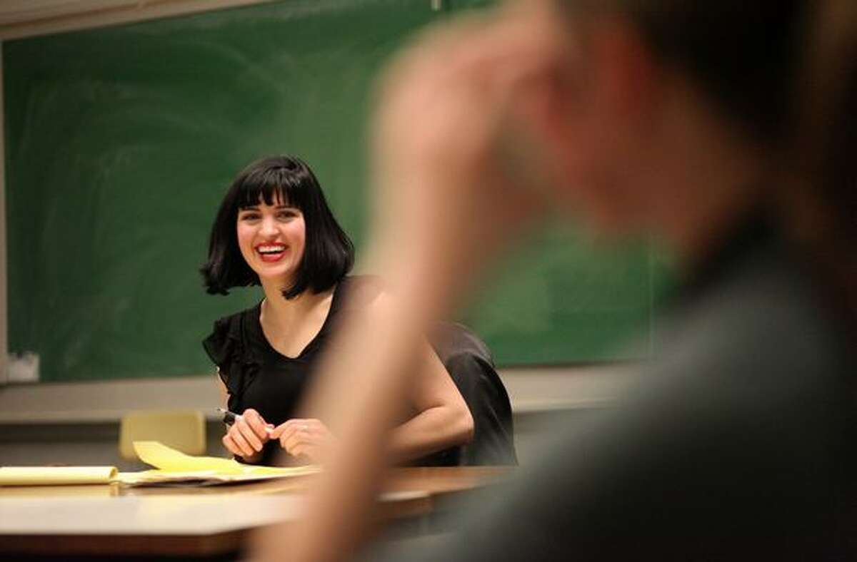 Instructor Kate Stewart works with students during a session of Flirting 101, a course offered by the University of Washington Experimental College, on Thursday, Feb. 10, 2011. Stewart, a psychotherapist and dating expert, instructs the students on the