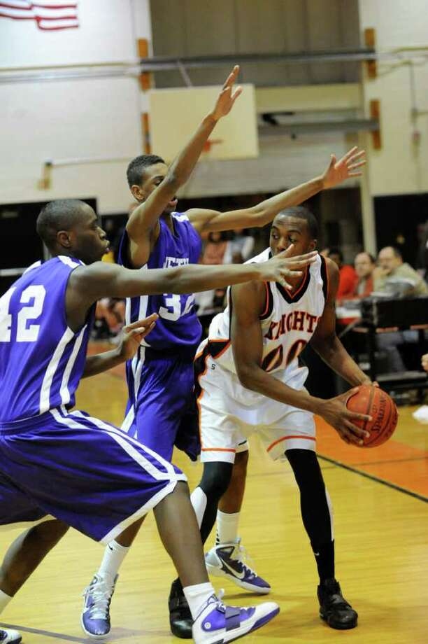Westhill's Sam Dorissant ad Chris Walters and Stamford's Luis Briddter during Westhill @ Stamford boys basketball in Stamford, Conn. on Monday February 14, 2011. The score was Stamford 55 Westhill 49. Photo: Dru Nadler / Stamford Advocate Freelance
