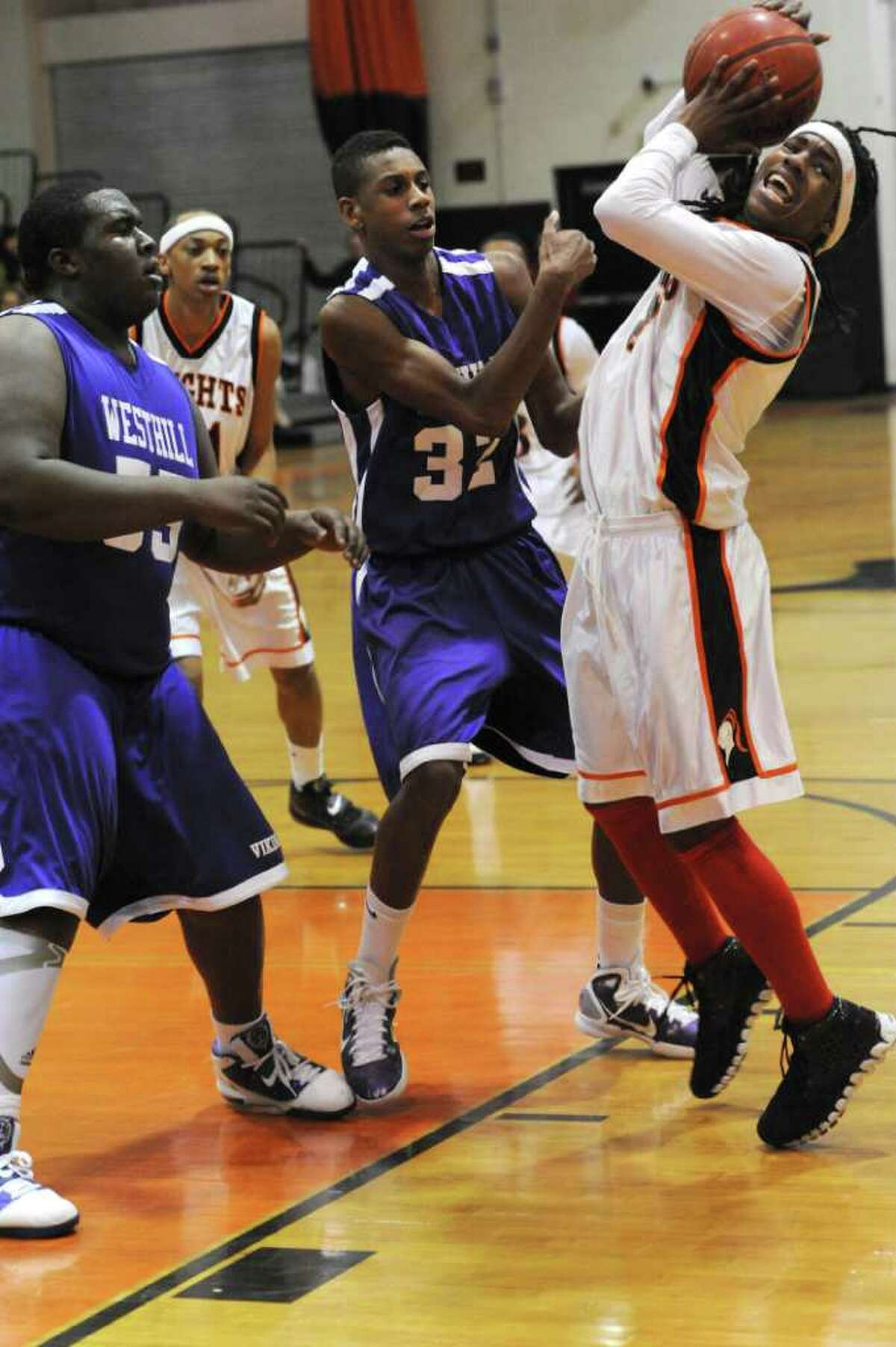 Westhill's Ervin Thompson and Chris Walters and Stamford's Jakai Wilson during Westhill @ Stamford boys basketball in Stamford, Conn. on Monday February 14, 2011. The score was Stamford 55 Westhill 49.